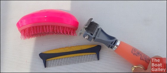 """One big worry about cruising with a dog is what to do about grooming. Eleven years with a """"poodle-ish"""" mix has taught us quite a bit about DIY grooming . . . and it's really not hard!"""