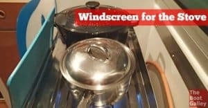 Can't keep your stove lit as wind comes through the galley and keeps blowing it out? Use a windscreen -- here's a couple of ideas.